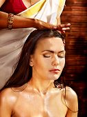foto of panchakarma  - Young woman having head ayurveda spa treatment - JPG