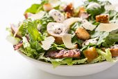 stock photo of bacon  - Bowl of Traditional Caesar Salad with Chicken and Bacon - JPG