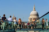LONDON, UK - CIRCA OCTOBER 2011: People walking on The Millennium Bridge with St Paul's cathedral in