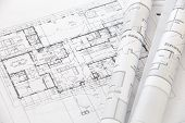 stock photo of mechanical drawing  - close up Architect rolls and plans architectural plan - JPG