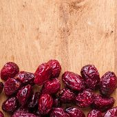 Diet Healthy Food. Border Of Dried Cranberries On Wooden Background