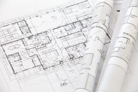 image of mechanical drawing  - close up Architect rolls and plans architectural plan - JPG
