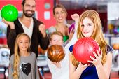 image of health center  - Parents playing with children together at bowling center - JPG