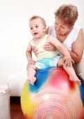 stock photo of nana  - Small boy have a fun with the gymnastic ball - JPG