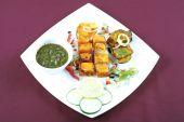 foto of paneer  - paneer tikka in plate for dinner time at home - JPG