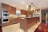 picture of light fixture  - Kitchen in luxury home with oak wood cabinetry - JPG