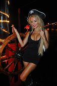 image of playmate  - Model poses sexy at Pirates boat wearing carnival costume - JPG