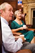 foto of old couple  - Group of happy older senior friends enjoying each others company in an expensive hotel - JPG