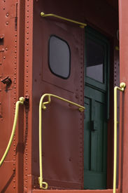 stock photo of caboose  - In the door of a red caboose with yellow hand rails - JPG