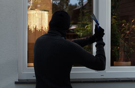 stock photo of unsafe  - The burglar trying to break into someone - JPG