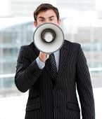 Stressed Businessman Yelling Through A Megaphone