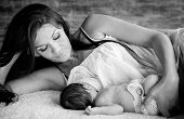 stock photo of child feeding  - beautiful mother feeding her newborn with breast  - JPG