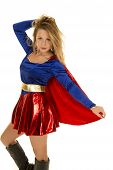 foto of short-story  - A woman in her super hero costume holding on to her cape - JPG