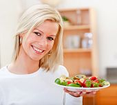 stock photo of healthy eating girl  - Healthy eating woman with fruits and smiling - JPG