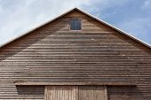 picture of gable-roof  - Looking up at the top of a gabled roof on a wooden barn - JPG