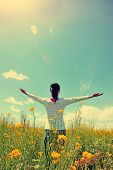 foto of open arms  - cheering woman open arms at cole flower field - JPG