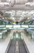 foto of escalator  - Blurred image of moving modern escalator way in the airport hall - JPG
