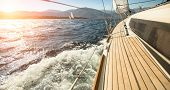 stock photo of yachts  - Yacht sailing towards the sunset - JPG