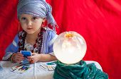 foto of epiphany  - little child plays to be a fortune teller