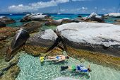 picture of virginity  - Family of young mother and son snorkeling in turquoise tropical water among huge granite boulders at The Baths beach area major tourist attraction on Virgin Gorda - JPG