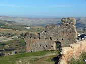 image of slit  - An old wall including arrow slits of the ancient Roman Volubilis near Fes in Morocco - JPG