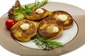 stock photo of hash  - Hash browns with herbs on the plate - JPG