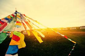foto of tibetan  - Buddhist tibetan prayer flags in tibet china - JPG