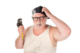 picture of wife-beater  - Puzzled plumber with pipe wrench and cigar - JPG