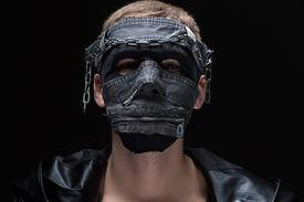 stock photo of madman  - Photo of madman in handmade mask on black background - JPG