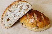 image of whole-grain  - Fresh whole grain bread cut in half on cutting board - JPG
