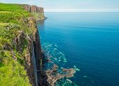 stock photo of kilt  - Waterfall and Kilt rock on the Isle of Skye in Scotland - JPG