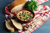 pic of fresh slice bread  - Bean soup in bowl with fresh sliced bread on napkin - JPG