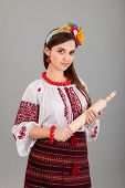 Housewife With Rolling Pin. Woman Wears Ukrainian National Dress poster