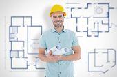 foto of blueprints  - Happy male architect holding blueprints against blueprint - JPG