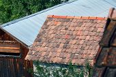 picture of gable-roof  - roof of the house with old tiles in a village  - JPG