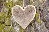 picture of carving  - carved wooden heart as symbol for love - JPG
