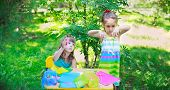 image of scissors  - Girls sisters kids friends cutting multicolored paper outdoors classroom playing in the garden - JPG