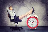 picture of big-foot  - Businesswoman sits in chair - JPG