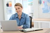 stock photo of stressless  - Businesswoman working from home on laptop - JPG