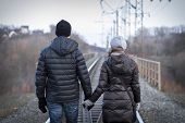 foto of windy weather  - Young couple posing outdoor in cold windy weather - JPG