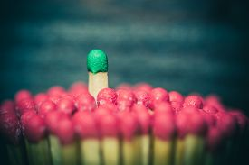 picture of leadership  - One match standing out from the crowd leadership difference concept - JPG