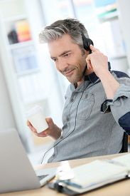 pic of stressless  - Mature man teleworking from home with laptop  - JPG