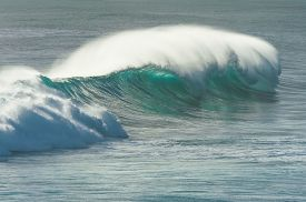 image of horsetail  - Big wave breaking offshore trailing long white horsetail of spray - JPG