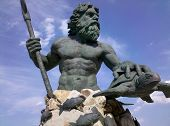 foto of poseidon  - a weathered statue of poseidon or triton - JPG