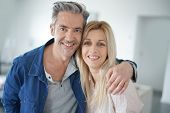 Portrait of loving middle-aged couple poster