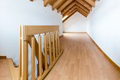 Empty Spacious And Bright Attic In A Refurbished Apartment With Wooden Parquet Floor And White Walls poster