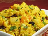 stock photo of indian food  - A colorful Indian rice dish made from basmati rices spices and fresh vegetables - JPG