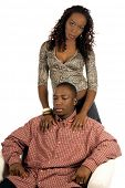 picture of black american  - Sexy African American woman in a casual denim skirt and snake skin print top standing by a man sitting in a white chair - JPG