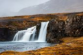 Famous Kirkjufellsfoss Waterfal In Snaefellsnes Peninsula Of Iceland poster
