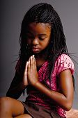 stock photo of pre-teen girl  - Portrait of a Young African American girl praying - JPG